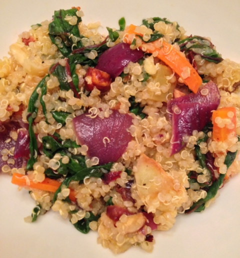 Quinoa with roasted red onions, carrots, white sweet potatoes and garlic with Swiss chard