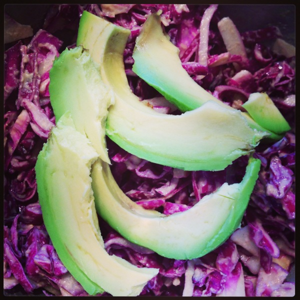 Raw red cabbage slaw with sliced avocado. Clean and refreshing!