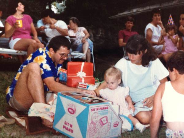 Celebrating my first birthday 30 years ago in my parents' backyard! That standup piano must have been my introduction to music!